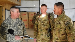 AFGHANISTAN — Command Sgt. Maj. Michael Buxbaum, senior enlisted adviser for U.S. Army Corp of Engineers, visits with Capt. Michael Carroll, commander of Forward Support Company, 7th Engineer Battalion, and Chief Warrant Officer 2 Stanley Hutto during a visit to Forward Operation Base Shank, Afghanistan.