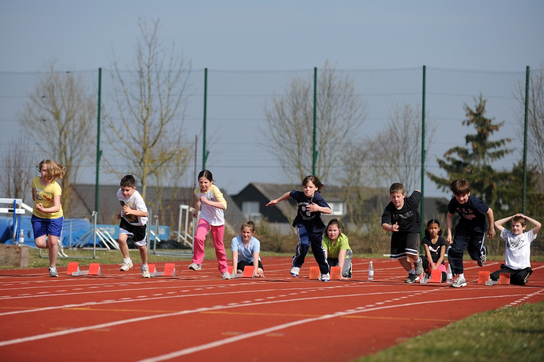 BITBURG ANNEX, Germany – Spangdahlem and Bitburg Elementary School students begin the 100-meter dash during a track and field day at Bitburg High School track here March 24. The BHS track team hosted the event to introduce the first- through sixth-grade students to the sport's events. The team taught students about track and field to promote interest in staying active and healthy. (U.S. Air Force photo by Airman 1st Class Matthew B. Fredericks/Released)