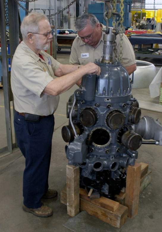 DAYTON, Ohio (03/2012) -- Charlie Leist (left) and Charlie Farlow are two of the volunteers working on the R-1535-7 engine. (U.S. Air Force photo)
