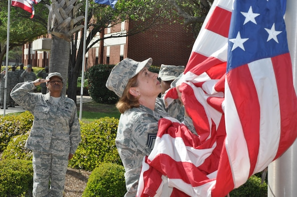 Women from Joint Base Charleston fold the flag during an all female retreat ceremony on March 23 to celebrate Women's History Month. About forty women from the 628th Air Base Wing, the 437th and 315th Airlift Wings took part in the ceremony. (U.S. Air Force photo/Michael Dukes)