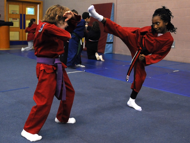 RAF MILDENHALL, England -- Maximus DeMarco blocks a high kick from Ahmira Palmer during the RAF Mildenhall Youth Center's Karate Camp March 15, 2012. The students learned moves associated with the martial arts styles of taekwondo and hapkido.  (U.S. Air Force photo/Staff Sgt. Thomas Trower)