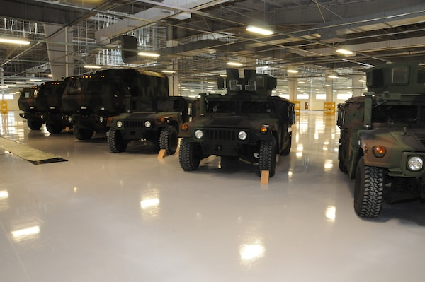Vehicles are lined up for display during the ribbon cutting ceremony for the new humidity controlled warehouse at Camp Carroll Feb. 10.  The new facility built by the U.S. Army Corps of Engineers, Far East District will be able to house 750 vehicles at full capacity.