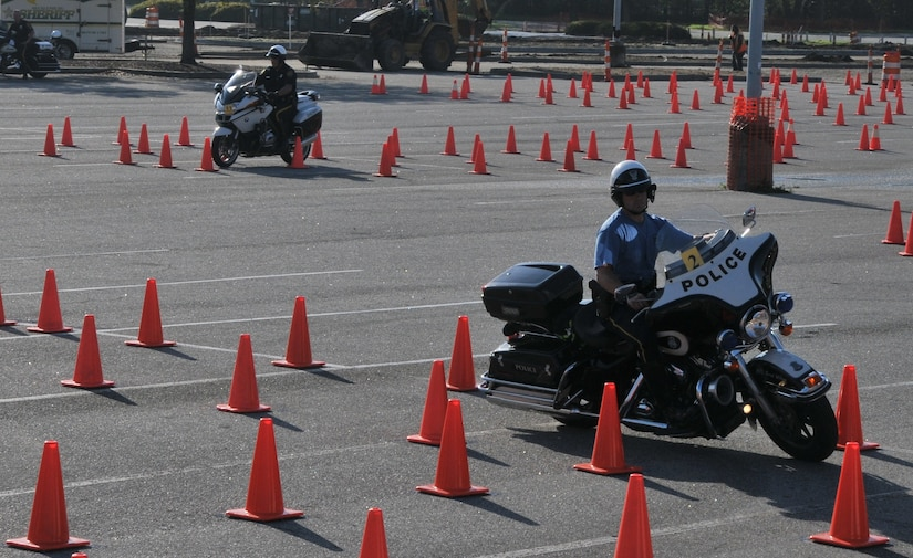 A police officer shows off his maneuvering skills March 23 during the Seventh Annual Palmetto Police Motorcycle Rodeo. The rodeo was one of the stops during the 2012 Joint Base Charleston Motorcycle Safety Event. The event provided motorcyclists with information about safe riding, motorcycle laws in South Carolina, military regulations and proper riding equipment.  (U.S. Air Force photo/Airman 1st Class Jared Trimarchi)