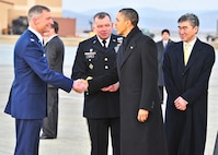 Col. Patrick McKenzie, the 51st Fighter Wing commander, shakes hands with President Barack Obama at Osan Air Base, South Korea, March 25, 2012, during introductions by Gen. James Thurman, the U.S. Forces Korea commander. The president transited the base on his way to the 2012 Nuclear Security Summit in Seoul, South Korea. (U.S. Air Force photo/Senior Airman Adam Grant)