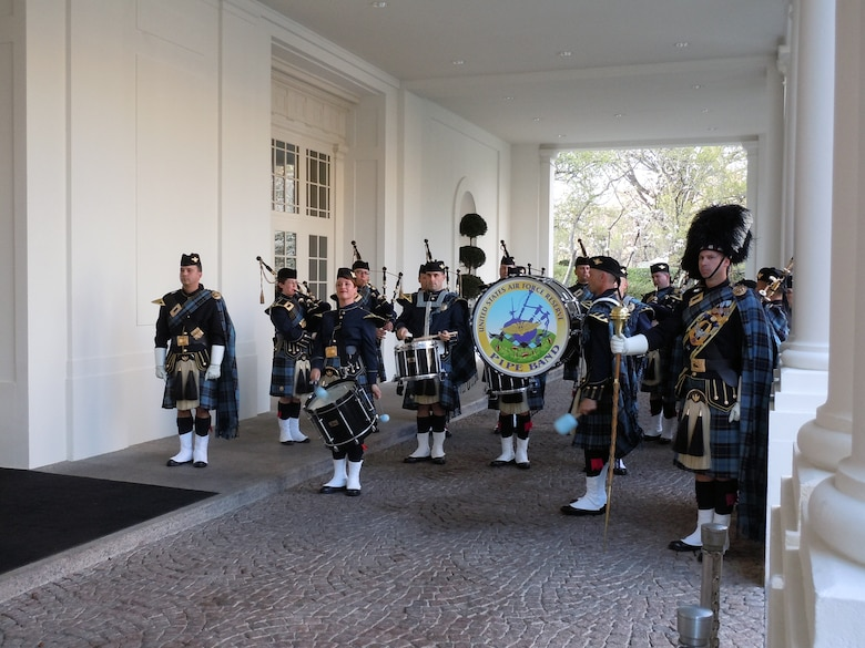 The Band of the Air Force Reserve's pipe band performs at the Carraige Entrance of the White House March 20, 2012, in Washington, D.C. They performed four missions for President Barack Obama and Irish Prime Minister Enda Kenny. The pipers have performed this mission every year since 1995, Elements of the Reserve band perform an average of 279 missions annually in support of Regular Air Force and Air Force Reserve mission taskings. (U.S. Air Force photo by Chief Master Sgt. Mark Burditt)
