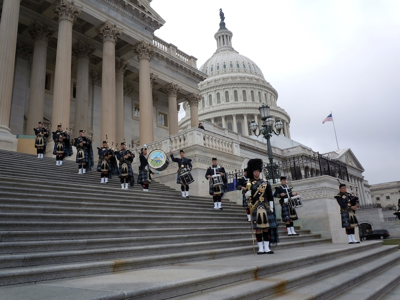 The Band of the Air Force Reserve's pipe band performs on the steps of the Capitol building March 20, 2012, in Washington, D.C. They performed four missions for President Barack Obama and Irish Prime Minister Enda Kenny. The pipers have performed this mission every year since 1995, Elements of the Reserve band perform an average of 279 missions annually in support of Regular Air Force and Air Force Reserve mission taskings. (U.S. Air Force photo by Chief Master Sgt. Mark Burditt)