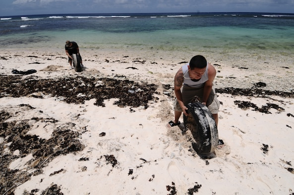 Airmen from the 36th Security Forces Squadron spend time cleaning Tangisen Beach in the Dededo, Guam, March 22.  Assisting in such events allow Team Andersen Airmen to get out and enjoy Guam while participating in the local community.  (U.S. Air Force photo/Airman 1st Class Mariah Haddenham)