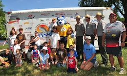 Old Hickory Lake park rangers Noel Smith (left), Charlie Leath (middle), and Trey Church (right) pose with an Old Hickory Percy Priest Bass Tournament Club official, Nashville Predators mascot Gnash, and the children that participated in the Kid's Fishing and Family Fan Day Tournament.