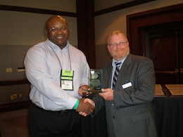 SAN DIEGO -- U.S. Army Corps of Engineers Old Hickory Lake natural resource manager Frederick Bell (left) receives the Award of Merit for the National Water Safety Congress Region 3 Vice President Ernest Lentz March 5, 2012 during the National Water Safety Congress during the International Boating and Water Safety Summit.