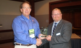 SAN DIEGO -- U.S. Army Corps of Engineers Lake Barkley natural resource manager Michael Looney (left), receives the Award of Merit from the National Water Safety Congress Region 3 Vice President Ernest Lentz March 5, 2012, during the National Water Safety Congress during the International Boating and Water Safety Summit.