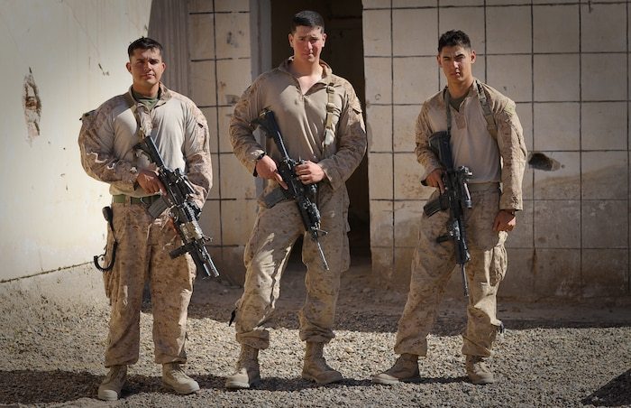 COMBAT OUTPOST CASTLE, Afghanistan – Sergeant Eriek Gutierrez, a squad leader, Lance Cpl. Benjamin Nalls, a light armored vehicle crewman, and Lance Cpl. Christopher D. Bast, a fire team leader, all serving with 1st Platoon, Delta Company, 1st Light Armored Reconnaissance Battalion, pose for a photo here, March 21, 2012. The three Marines were on an evening resupply patrol to another squad of Marines near a small village in Helmand province's Khan Neshin district, Feb. 23, when they fell in a 15-foot-wide canal at separate times. Each participated in the successful rescue of his fellow Marines, with Nalls jumping back in the near-freezing water when Gutierrez fell in the canal.
