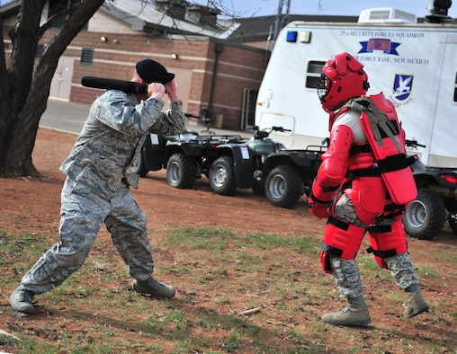 U.S. Air Force Tech. Sgt. William Lannon, 27th Special Operations Security Forces Squadron patrolman, demonstrates baton training on another 27 SOSFS member at Cannon Air Force Base, N.M., March 21, 2012. Security forces members conduct training throughout the year to maintain certifications, qualifications and mission readiness. (U.S. Air Force photo by Airman 1st Class Alexxis Pons Abascal)