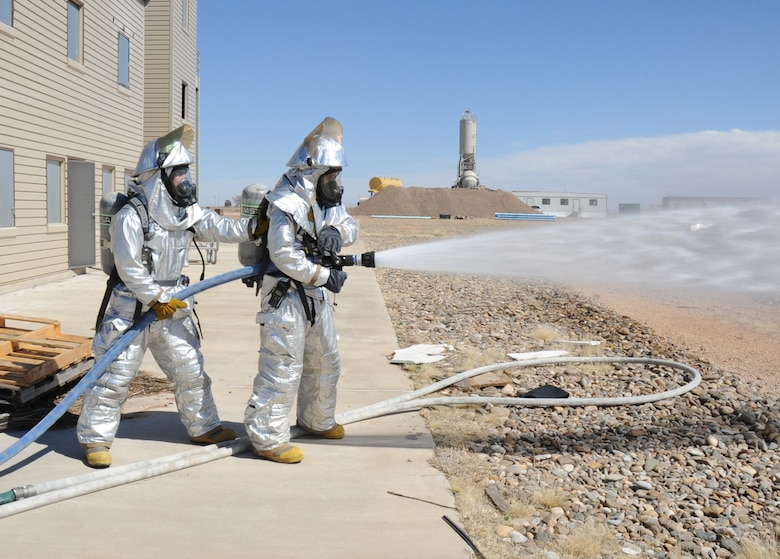 U.S. Air Force firefighters with the 27th Special Operations Civil Engineer Squadron check water functionality and pressure during a controlled burn at Cannon Air Force Base, N.M., March 15, 2012. Firefighting crews routinely perform exercises like this controlled burn to ensure readiness during an actual disaster. (U.S. Air Force photo by Airman 1st Class Alexxis Pons Abascal)