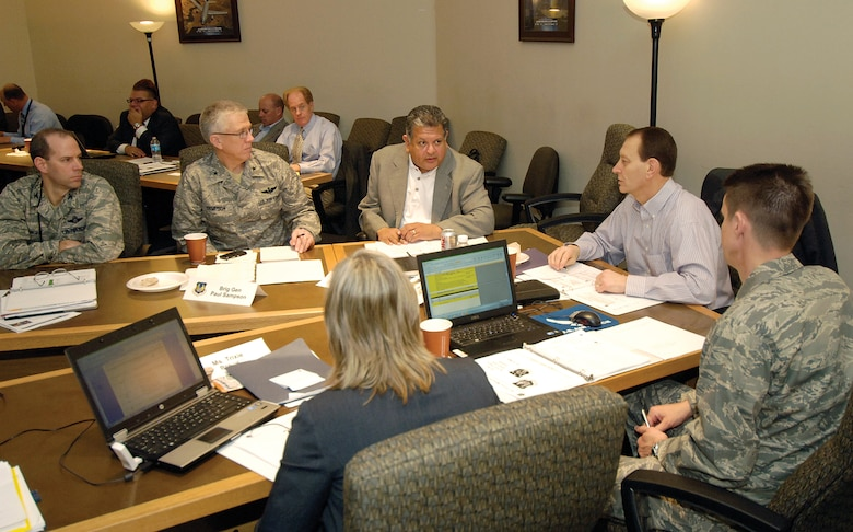 During an Air Force Sustainment Center face-to-face Core Team Planning Meeting March 14-16 at Tinker Air Force Base, senior leaders and AFSC Core/Sub-Team members from across the command discuss the way ahead for the future AFSC. Pictured are, front from left, Trixie Brewer, AFSC Core Team Lead/591st Supply Chain Management Group deputy director, Air Force Global Logistics Support Center; and Col. Tom Miller, AFSC Core Team Lead/Ogden Air Logistics Center vice commander; back from left, Col. Mallory Knight,  AFSC Functional Lead for Engineering/Oklahoma City Air Logistics Center Directorate of Engineering & Technical Management deputy director; Brig. Gen. Paul Sampson, Air Force Materiel Command mobilization assistant to the commander; Gil Montoya, AFSC Logistics Stand-Up Lead/448th Supply Chain Management Wing director, AFGLSC; and Ross Marshall, AFSC Stand-Up Lead/OC-ALC executive director.(Air Force photo by Margo Wright)
