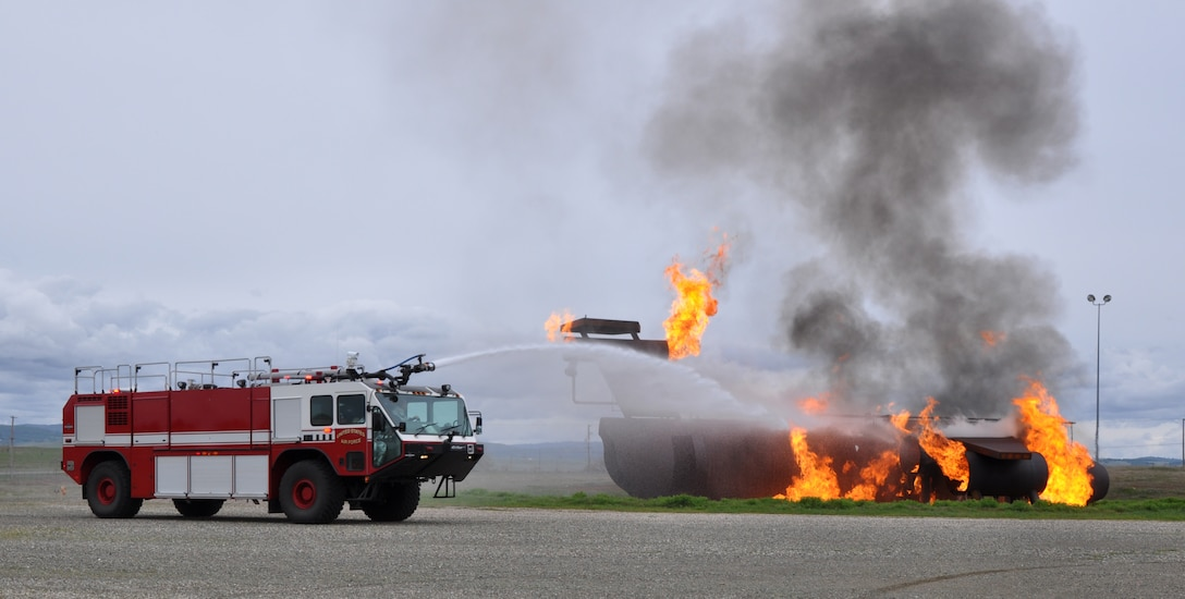 A Beale fire truck sprays down a simulated aircraft fire at Beale Air Force Base, Calif., March 19, 2012. Five trucks and 16 personnel were used to combat the simulated aircraft crash. (U.S. Air Force photo by Staff Sgt. Robert M. Trujillo/Released)