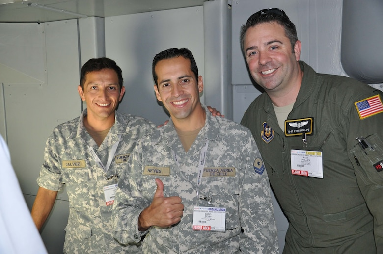 "SANTIAGO, Chile –Tech. Sgt. Ryan Phillips, a crew member on the KC-10 Extender with the 349th Air Mobility Reserve Wing from Travis AFB, Calif., and two members of the Chilean air force gives a ""thumbs-up"" to U.S.-Chilean Air Force partnerships in South America at the FIDAE air show in Santiago, Chile, March 27. FIDAE is an opportunity to build camaraderie, share our common Airman culture and strengthen our bonds with our South American partner nations. (U.S. Air Force photo/Master Sgt. Kelly Ogden)"