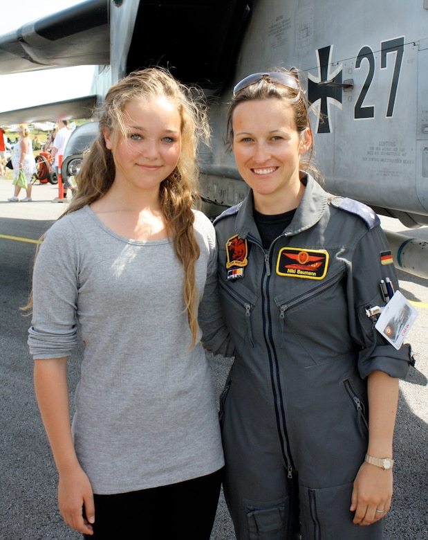 1Lt. Nicola Baumann, an instructor pilot with the 459th Flying Training Squadron, poses for a picture during an air show in Germany in this undated photo.  Baumann became just the second female fighter pilot in the history of the German Air Force back in 2007 after completing the Euro-Nato Joint Jet Pilot Training program at Sheppard Air Force Base, Texas.  (U.S, Air Force photo/Dan Hawkins)