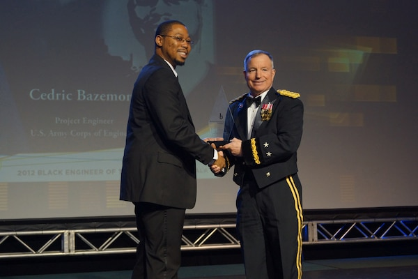 Cedric V. Bazemore is congratulated by Major General Merdith W. B. (Bo) Temple, USACE Chief of Engineers at the 26th BEYA STEM conference Black Engineer of the Year Awards Gala in Philadelphia.
