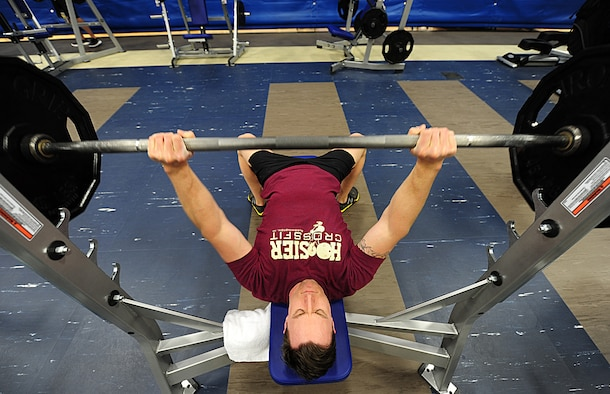 Staff Sergeant Matt Todd, 92nd Logistics Readiness Squadron, bench-presses at the new facility March 26. The fitness center is open seven days a week. Monday through Friday from 4:30 a.m. to 10:30 p.m. and Saturdays and Sundays from 7 a.m. to 8 p.m. (U.S. Air Force photos by Airman 1st Class Taylor Curry)
