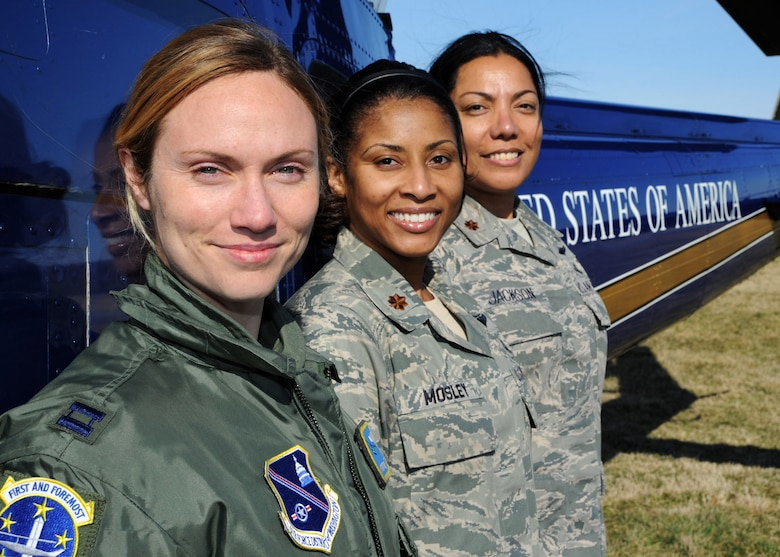 From left to right, Capt. Margaret McCord, 1st Helicopter Squadron pilot, Maj. Tammy Mosley, 779th Medical Operations Squadron nurse and Maj. Jacqueline Jackson, 579th Medical Group flight nurse, proudly represent Joint Base Andrews at the Women of Aviation Worldwide Week's Fly it Forward Day in Frederick, Md. on March 10. Giving Jackson an incentive flight on her birthday, McCord flew the UH-1N Iroquois to an air show where the women met up with Mosley and together enlightened local community members of the Andrews mission. (U.S. Air Force photo/Senior Airman Laura Turner)