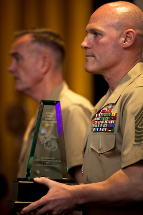 Sgt. Maj. Micheal P. Barrett, sergeant major of the Marine Corps, holds the Marine Corps Warrior Preservation award at the Executive Force Preservation Board March 28 at the Sheraton Inn in Arlington. Each year, the Marine Corps Warrior Preservation award, the Marine Corps Individual Superior Achievement in Safety awards and the Marine Corps Achievement in Safety awards are presented to one installation, three individuals and three commands that contributed the most to safeguarding the Corps' Marines, sailors and civilians.
