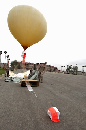 Communications Marines from the 15th Marine Expeditionary Unit, release the Combat SkySat communication system at Camp Pendleton, Calif., March 29, allowing the helium balloon to float to Earth's stratosphere. The SkySat system is used to retransmit UHF signals to increases the range of communication up to 600 miles in diameter and expands the capabilities of the Marine Air Ground Task Force.::r::::n:: ::r::::n::