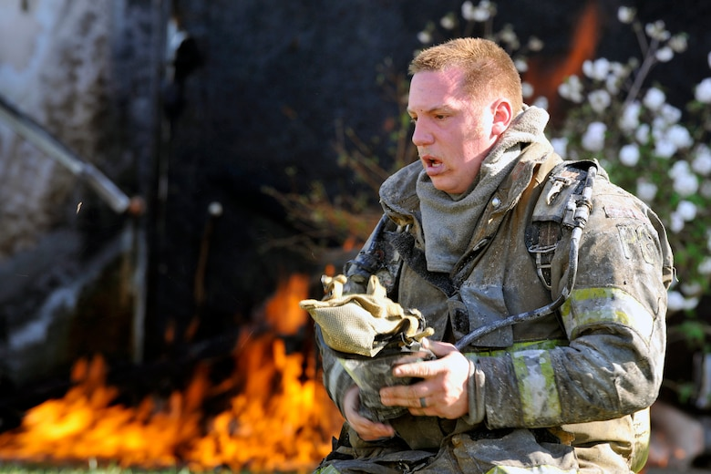 A Prince George's County firefighter takes off his self-contained breathing mask after fighting a house fire here March 29. Firefighters from the 11 CES and two stations in Prince George's County fought the flames that damaged multiple surrounding homes. (U.S. Air Force photo/Senior Airman Perry Aston)