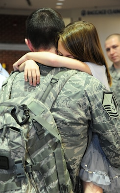 Master Sgt. Robby G. Kindernay, 42nd Security Forces Squadron, reunites with his children at Montgomery Regional Airport in March 2011. Kindernay, who was deployed for six months to Afghanistan, was greeted by his wife, Tech. Sgt. Jennifer Kindernay, and their two children, Ashlyn and Dalton. Programs at the Airman and Family Readiness Center help families of deployed military members, who face adjustments throughout the deployment cycle. (Air Force photo/Senior Airman Christopher S. Stoltz)