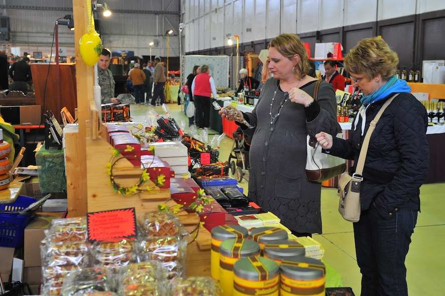 SPANGDAHLEM AIR BASE, Germany – Chi Anne McGrew, left, wife of Thomas McGrew, 52nd Civil Engineering Squadron, and Philippa Brathoude shop for assorted chocolate treats at the spring bazaar here March 30. The Spangdahlem Spouses and Enlisted Members Club hosts the bazaar annually allowing vendors from across Europe to share their products with military members and their families. Products include foodstuffs, furniture and traditional German décor. (U.S. Air Force photo/Airman 1st Class Dillon Davis)