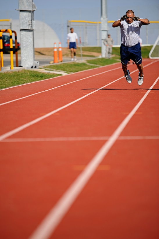 SPANGDAHLEM AIR BASE, Germany – Master Sgt. Jerry Torrez, 52nd Equipment Maintenance Squadron, performs a long jump during a relay for the Iron Flight Competition at the track here March 28. The quarterly competition is an incentive program intended to build comraderie and test the mental and physical endurance of the participating squadron members. Four teams participated in the six-person team competition that consisted of three different events. The 52nd Equipment Maintenance Squadron ammo team won the competition after a three-way tie-breaker rope-climbing event against the 52nd Civil Engineer Squadron and the 52nd Component Maintenance Squadron. (U.S. Air Force photo by Airman 1st Class Matthew B. Fredericks/Released)