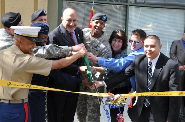 Dignitaries and armed forces representatives cut a ceremonial ribbon during the grand opening of L.A. Career Center March 28 in downtown Los Angeles, Calif. The U.S. Army Corps of Engineers Los Angeles District will manage the lease of the 50,000 square-foot recruitment center for future Soldiers, Airmen and Marines.