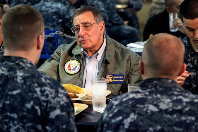 Secretary of Defense Leon Panetta gets to know sailors from the USS Peleliu, today, while enjoying lunch. During his visit, Panetta toured the ship, had lunch with Marines and sailors, re-enlisted and pinned awards on several service members and held a brief press conference with the media. Panetta came to visit the Marines and sailors to reinforce his commitment to maintaining an expeditionary fighting force.