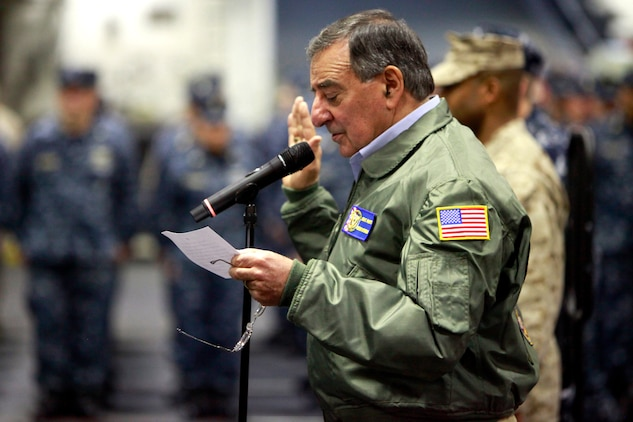 Secretary of Defense Leon Panetta reads the oath of enlistment as he reenlists several service members from the 15th Marine Expeditionary Unit and the USS Peleliu, today. During his visit, Panetta toured the ship, had lunch with Marines and sailors, pinned awards on several service members, and held a brief press conference with the media. Panetta came to visit the Marines and sailors to reinforce his commitment to maintaining an expeditionary fighting force.