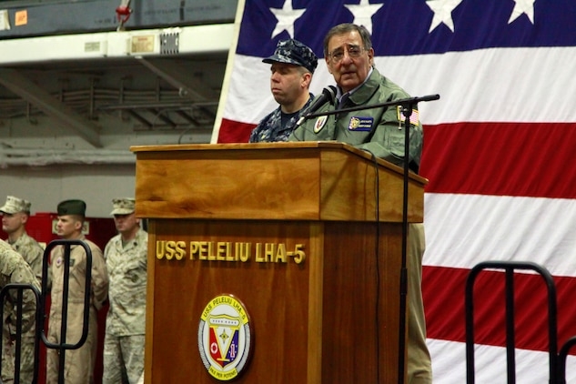 Secretary of Defense Leon Panetta speaks to service members from the 15th Marine Expeditionary Unit and the USS Peleliu, today. During his visit, Panetta toured the ship, had lunch with Marines and sailors, pinned awards on several service members, and held a brief press conference with the media. Panetta came to visit the Marines and sailors to reinforce his commitment to maintaining an expeditionary fighting force.::r::::n::::r::::n::