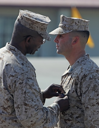 Maj. Gen. Ronald L. Bailey, commanding general, 1st Marine Division, pins the Silver Star on Sgt. Ryan T. Sotelo, Battalion Landing Team 3/5, 15th Marine Expeditionary Unit, at San Mateo, Calif., March 30. Sotelo received the award for actions he took as a squad leader with Kilo Company, 3rd Battalion, 5th Marine Regiment while deployed to Sangin District, Afghanistan.