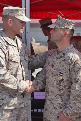 Sgt. Ryan T. Sotelo, Battalion Landing Team 3/5, 15th Marine Expeditionary Unit, shakes hands with Lt. Col. Christeon C. Griffin, battalion commander, 3rd Battalion, 5th Marine Regiment, after receiving the Silver Star at San Mateo, Calif., March 30. Sotelo received the United States' third highest award for combat valor for actions he took as a squad leader with Kilo Company, 3rd Battalion, 5th Marine Regiment while deployed to Sangin District, Afghanistan.