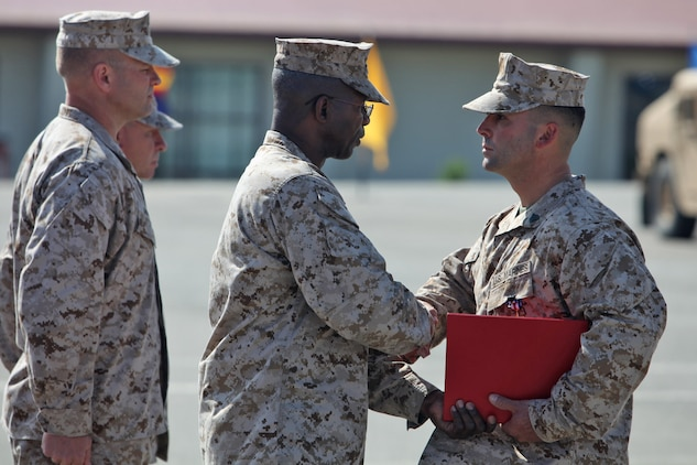 Sgt. Ryan T. Sotelo, Battalion Landing Team 3/5, 15th Marine Expeditionary Unit, shakes hands with Maj. Gen. Ronald L. Bailey, commanding general, 1st Marine Division, after receiving the Silver Star at San Mateo, Calif., March 30. Sotelo received the United States' third highest award for combat valor for actions he took as a squad leader with Kilo Company, 3rd Battalion, 5th Marine Regiment while deployed to Sangin District, Afghanistan.