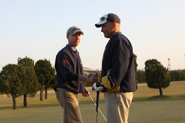 Col. James C. Stewart, Marine Corps Air Station Iwakuni commanding officer, and Sgt. Maj. Steven L. Brown, MCAS Iwakuni sergeant major, shake hands after the last round of golf ever to be played on the Torii Pines Golf Course April 1. Each recalled fond memories of the course and were reminded of days long gone but not without hopes toward the future.