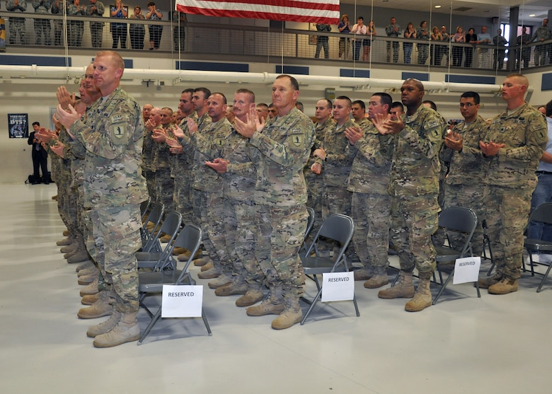 Members of Missouri National Guard's Agribusiness Development Team V applaud Family, friends and employers for supporting them while they were deployed for a yearlong mission in Nangarhar Province, Afghanistan.  A welcome home ceremony was held at Ike Skelton Training Site-Jefferson City, April 25. (Photo by Sarah Lupescu)