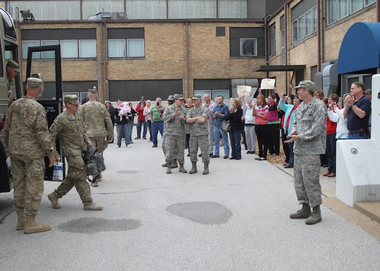131st Bomb Wing members of Agricultural Development Team-Five return to the welcome of family and friends, April 20, at Lambert Air National Guard Base-Saint Louis.  An official welcome ceremony was held at the Ike Skelton Training Site, Missouri National Guard Headquarters, April 25.  (Photo by Chief Master Sgt. John Youngstrom).