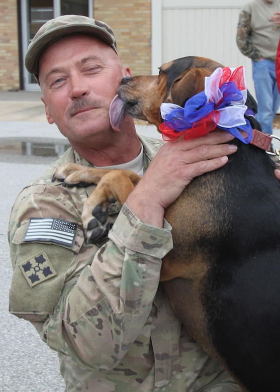 Master Sgt. Joe Holloway, 131st Bomb Wing Maintenance Group, is greeted by his dog Lucy on his return after a nearly yearlong deployment to Afghanistan.  131st Bomb Wing members of Agricultral Development Team-Five returned from deployment April 20 to Lambert Air National Guard Base-Saint Louis.  An official welcome ceremony was held at the Ike Skelton Training Site, Missouri National Guard Headquarters-Jefferson City, April 25.  (Photo by Chief Master Sgt. John Youngstrom).