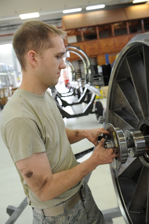SPANGDAHLEM AIR BASE, Germany – Senior Airman Braden Duke, 52nd Component Maintenance Squadron aerospace propulsion technician, takes apart the front frame of an F-16 Fighting Falcon turbine during the removal of all the moving parts of the engine at Bldg. 73 here April 30. Technicians replace all these parts of the engine at Bldg. 73 here April 30. Technicians replace these moving parts in a turbine every 4,000 flight hours as required by the service life extension program. CMS provides maintenance support to the 52nd Fighter Wing, the 31st FW at Aviano AB, Italy, and all U.S. F-16 units powered by F-110 engines in the European theater and deployed locations. (U.S. Air Force photo by Senior Airman Christopher Toon/Released)