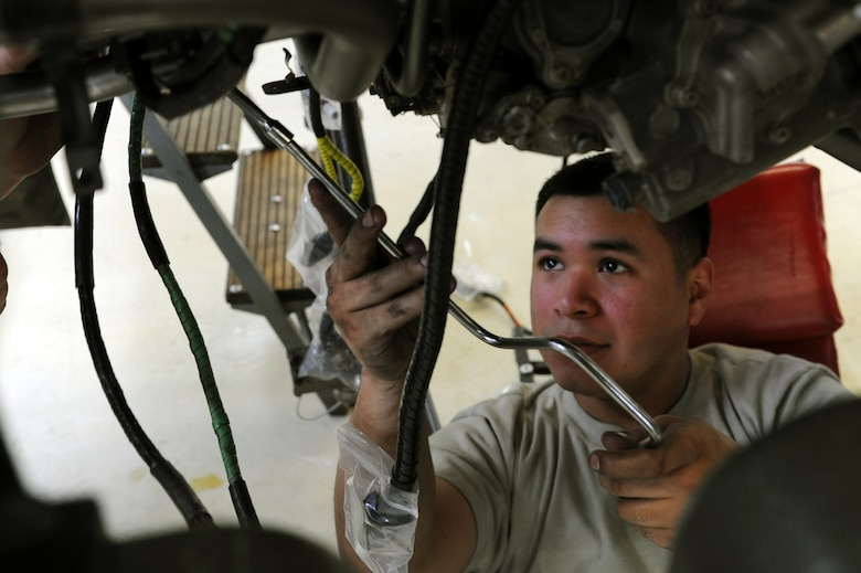 SPANGDAHLEM AIR BASE, Germany – Senior Airman Juan Serrano, 52nd Component Maintenance Squadron aerospace propulsion technician, removes bolts from an F-16 Fighting Falcon turbine frame to remove all moving parts of the engine at Bldg. 73 here April 30. Technicians replace these moving parts in a turbine every 4,000 flight hours as required by the service life extension program. CMS provides maintenance support to the 52nd Fighter Wing, the 31st FW at Aviano AB, Italy, and all U.S. F-16 units powered by F-110 engines in the European theater and deployed locations. (U.S. Air Force photo by Senior Airman Christopher Toon/Released)