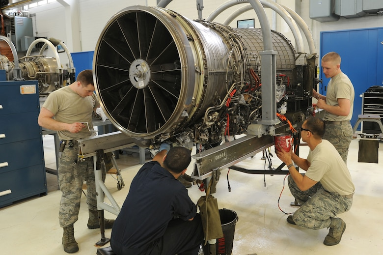 SPANGDAHLEM AIR BASE, Germany – Aerospace propulsion technicians from the 52nd Component Maintenance Squadron prepare an F-16 Fighting Falcon turbine to remove all moving parts of the engine at Bldg. 73 here April 30. Technicians replace these moving parts in a turbine every 4,000 flight hours as required by the service life extension program. CMS provides maintenance support to the 52nd Fighter Wing, the 31st FW at Aviano AB, Italy, and all U.S. F-16 units powered by F-110 engines in the European theater and deployed locations. (U.S. Air Force photo by Senior Airman Christopher Toon/Released)