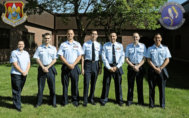 The application development team is shown here, from left to right: Senior Airman Amanda Voisin, Staff Sgt. Daniel Rich, Tech Sgt. David Carlson, Airman 1st Class Jacob Beeman, Master Sgt. Delbert Freeborn, Airman 1st Class Christopher Davies, 2nd Lt. Andrew Villagran. Capt. James Crawford is not shown. (U.S. Air Force photo by Staff Sgt. Ryan Crane)