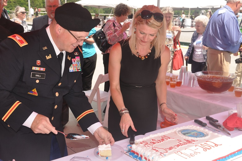 HARTWELL, Ga. — Col. Jeff Hall, Commander of the U.S. Army Corps of Engineers Savannah District, cuts a piece of cake at the 50th Anniversary Ceremony of the Hartwell Dam and Lake, April 27, 2012. Pictured with Hall is Angel Morrill of the Hartwell Project Office.