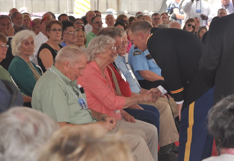 HARTWELL, Ga. — Col. Jeff Hall, Commander of the U.S. Army Corps of Engineers Savannah District, shakes hands with former Hartwell workers and their family members at the Hartwell 50th Anniversary Commemoration Ceremony, April 27, 2012.