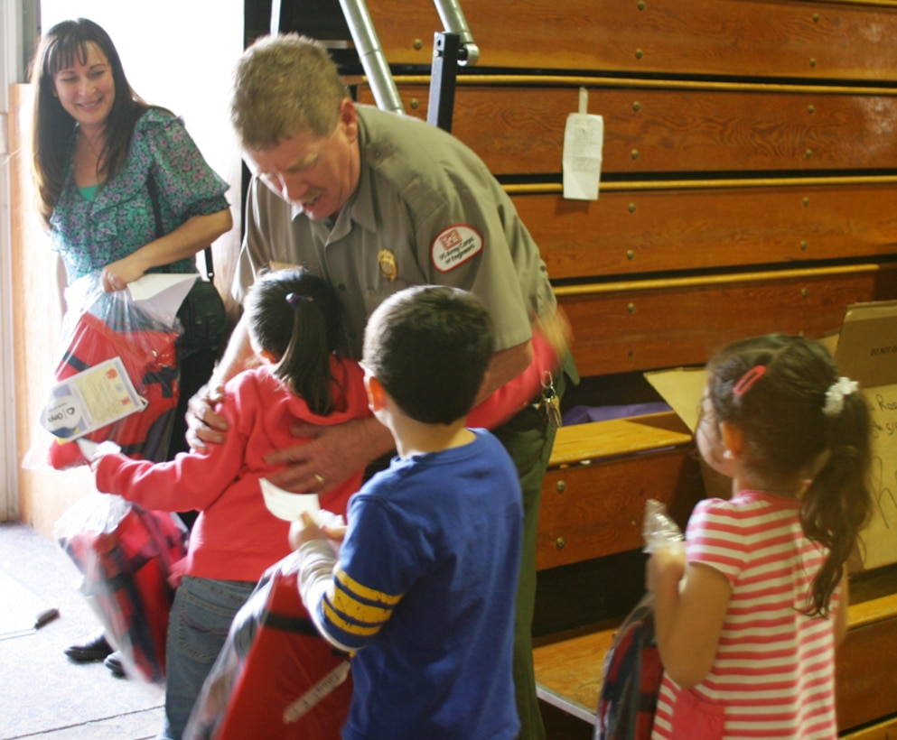 Park Ranger Robert Mumford helps distribute lifejackets to Santa Rosa Elementary School Students.  He reminds them to always wear a vest when on the water.