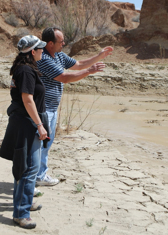 Project Manager Eddie Paulsgrove talks to Assistant Location Manager Jennifer Joyce about the intended film location.