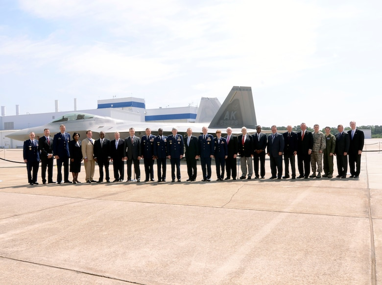 Air Force senior leaders and Lockheed Martin Aeronautical Company executives attend the formal ceremony unveiling the last F-22 Raptor at the Marietta, Ga. plant May 2. (U.S. Air Force photo/Don Peek)